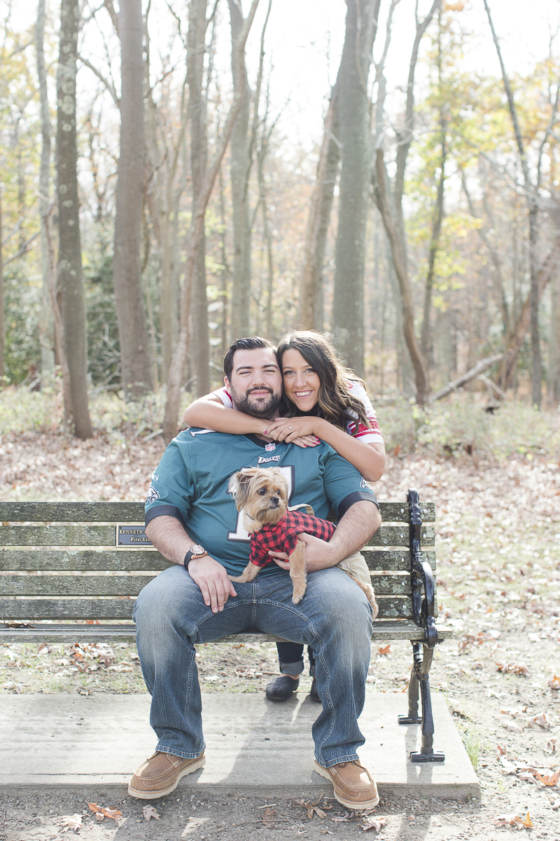 couple wearing football jerseys, park engagement photos with a dog | ©Limelight Entertainment Photography | dog friendly engagement session