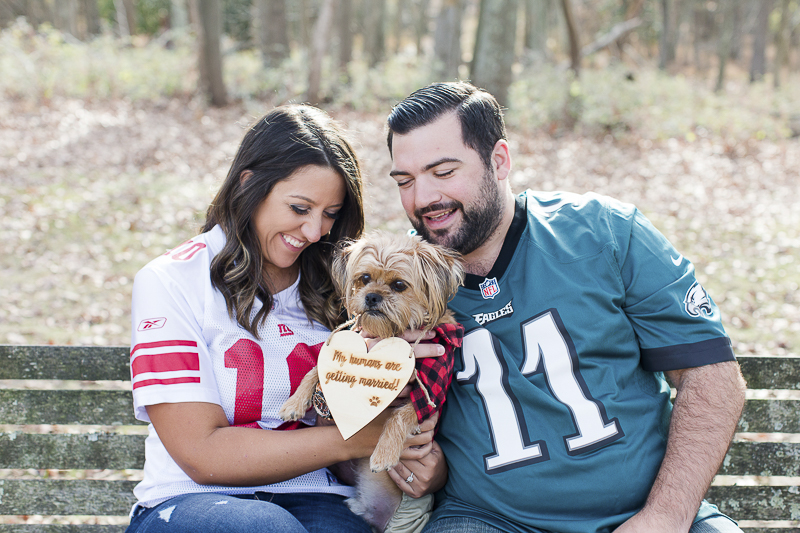 couple on bench with their small dog, ©Limelight Entertainment Photography | NJ dog friendly engagement session