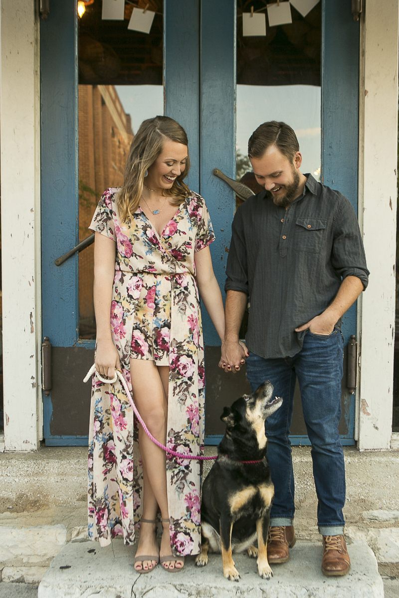 stylish couple looking down at their dog, ©Mandy Whitley Photography | Nashville Pet Photographer