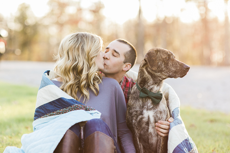 couple kissing while dog looks away, ©Sidney Leigh Photography | engagement pictures with a dog