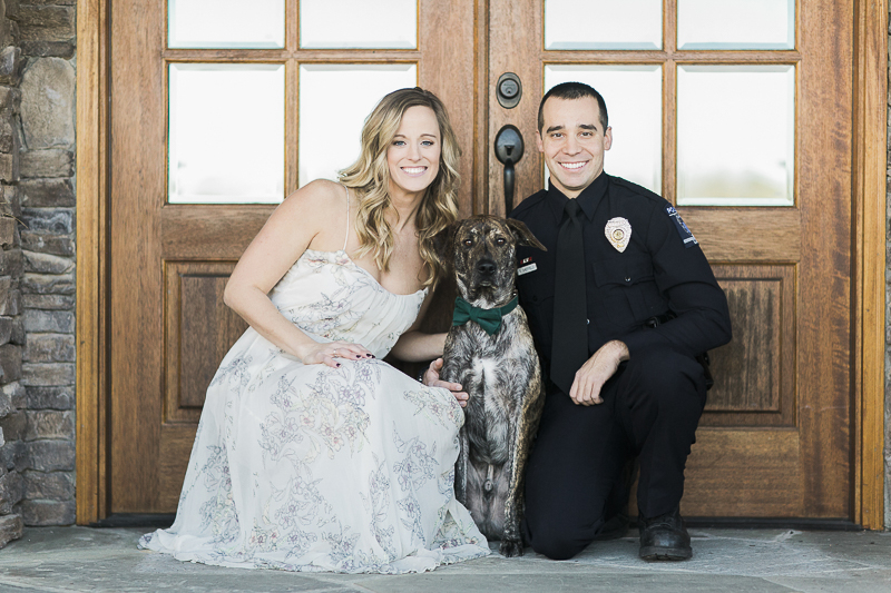 woman, dog, police officer in front of venue doors, ©Sidney Leigh Photography | Monroe, NC, engagement pictures with a dog