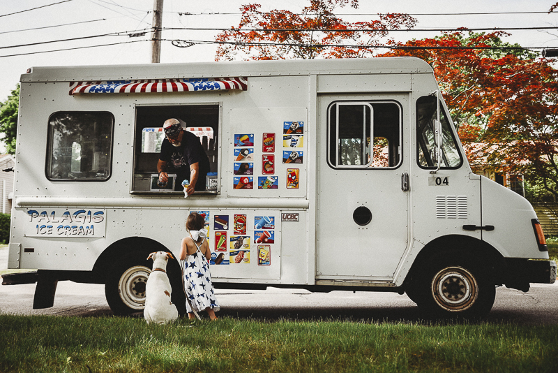 little girl and her puppy at ice cream truck, BFF, girl and her dog, Pit bull terrier mix