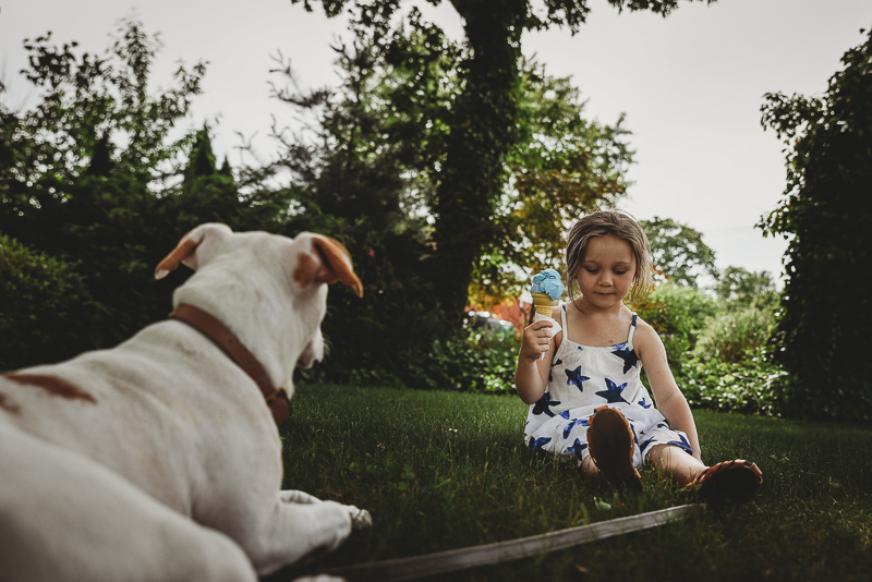 puppy watching little girl eat ice cream cone | Lifestyle dog photography ©Simply Perfect Photography