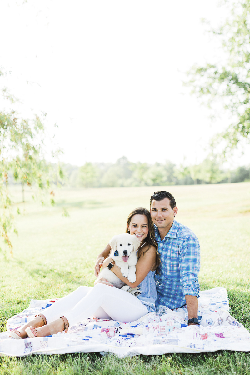 couple and their puppy sitting on quilt, ©Victoria Hunt Photography | Indiana lifestyle photography