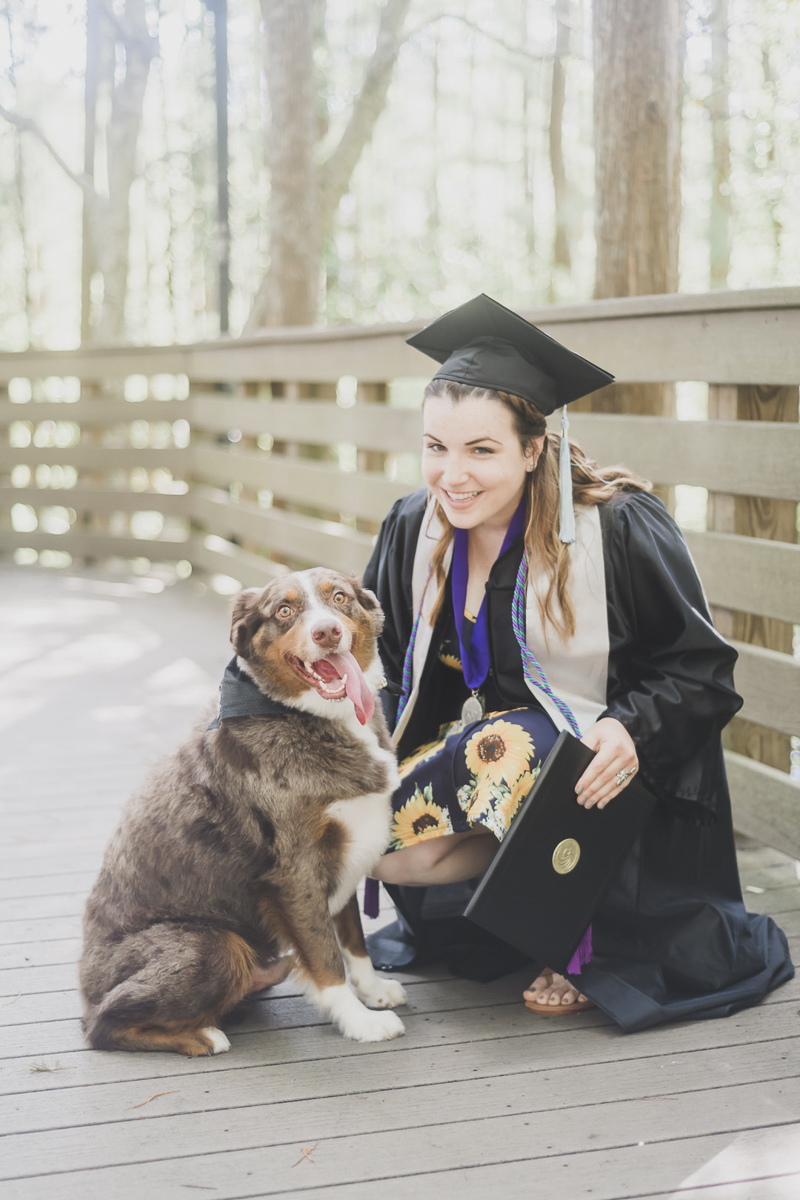 college graduate with her diploma and dog,  ©Haleigh Nicole Photography