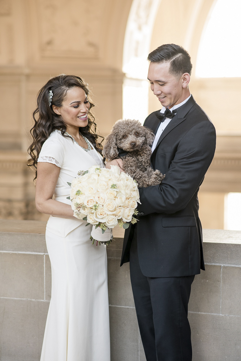 gorgeous bride and groom with toy poodle, wedding dog, ©Holly D Photography | dog friendly SF City Hall wedding