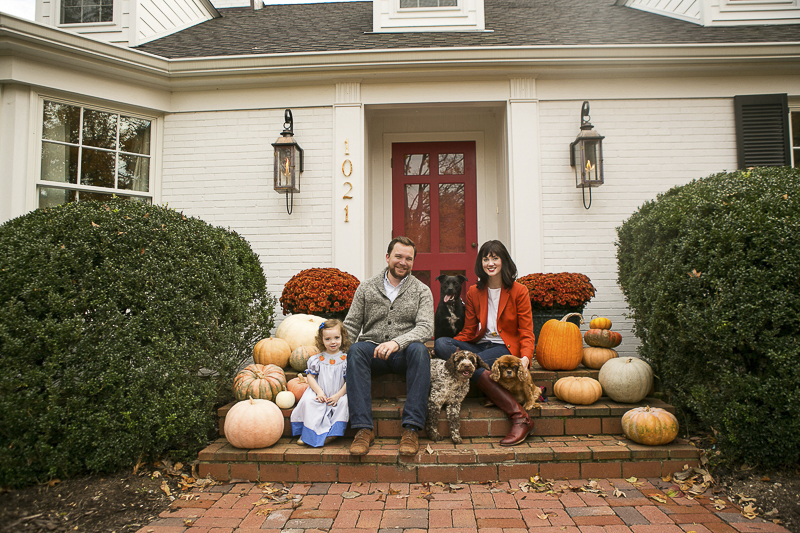 Nashville Fall family portraits, family and their dogs sitting on steps with pumpkins, ©Mandy Whitley Photography