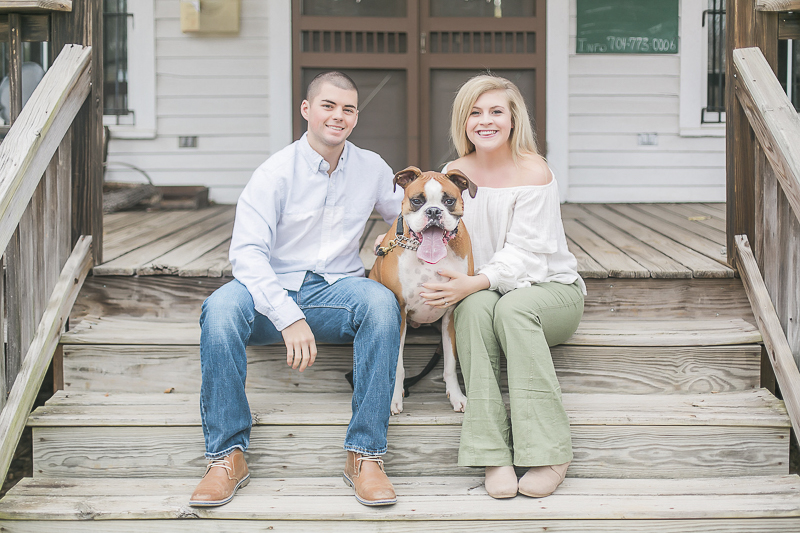 Boxer and couple sitting on steps | Charlotte dog-friendly engagement photographer