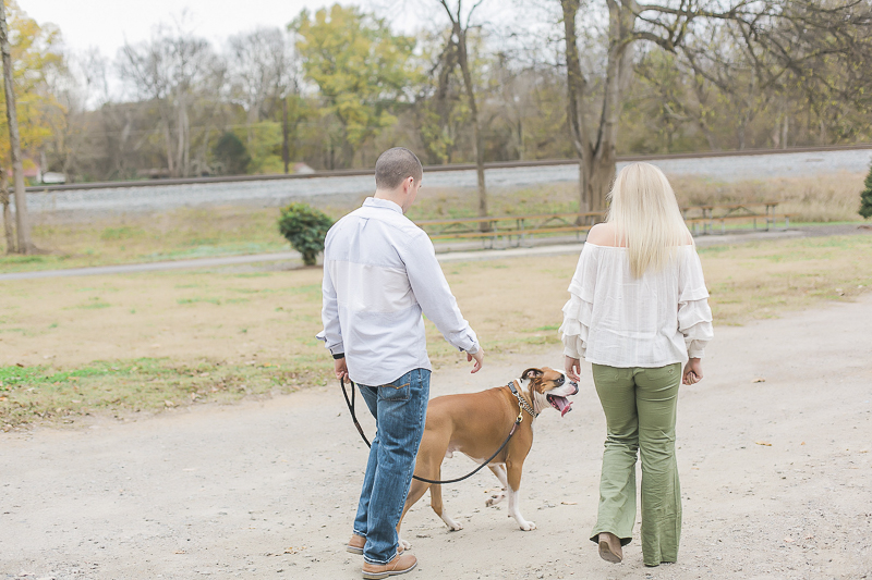 couple walking their dog, ©Casey Hendrickson Photography | engagement photos with dogs