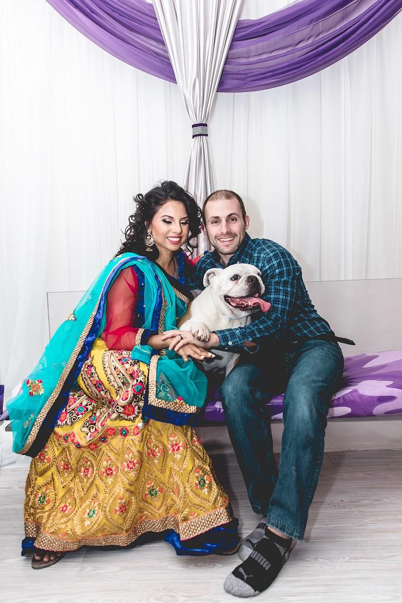 couple holding English Bulldog