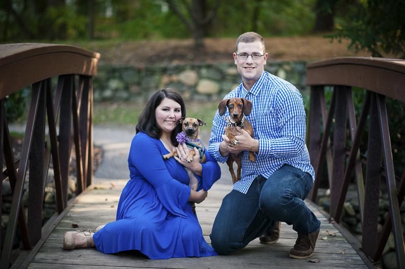 people and their pets, couple on bridge holding small dogs, Maryland lifestyle dog photographer ©Nina K Photography