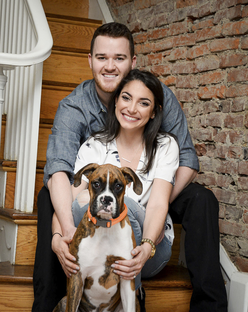 couple and their dog sitting on steps | creative ideas for dog friendly engagement photos