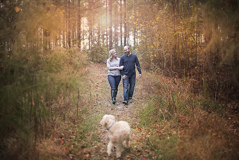couple walking through the woods with their dogs, fall family photos ©Alicia Hite Photography