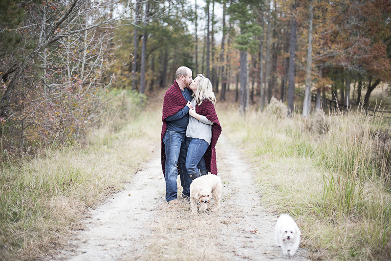 fall/winter family photo ideas, couple wrapped in blanket and their dogs on dirt road, ©Alicia Hite Photography | NC family photography, dog-friendly photographer,