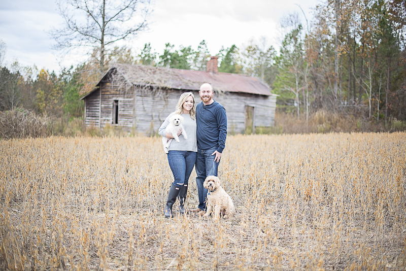 couple and their dogs in front of old farm building, lifestyle dog photography | ©Alicia Hite Photography