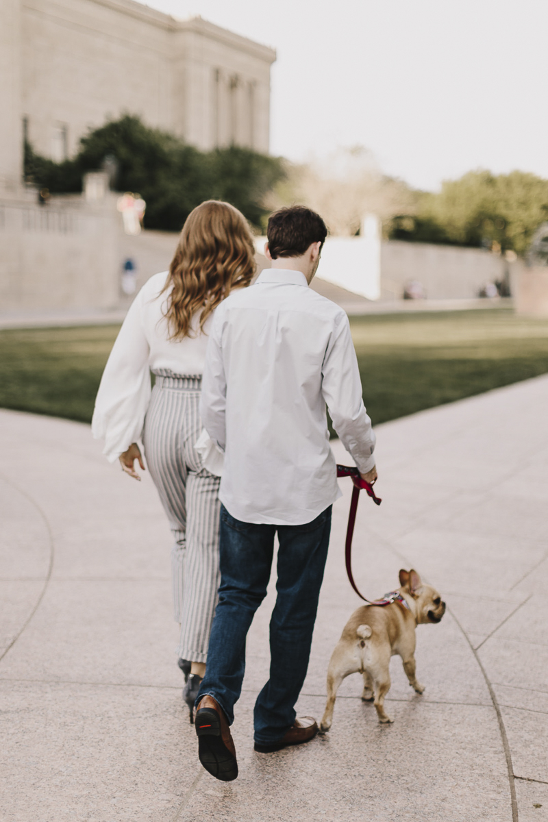 couple walking their Frenchie, ©Alyssa Barletter Photography | Kansas City Engagement Photos with a dog