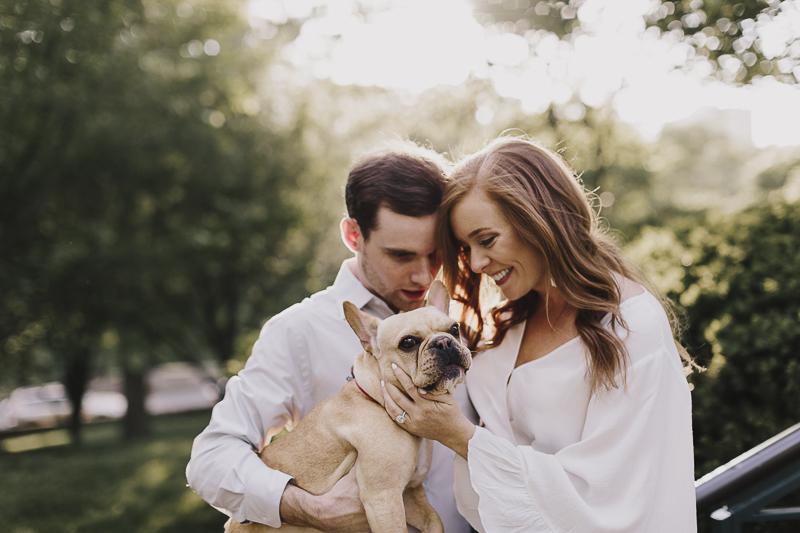 dog friendly engagement photos, couple holding French Bulldog