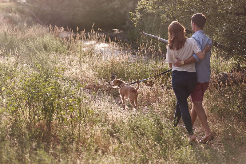 couple walking their dog in park | Colorado dog-friendly engagement session, ©Good Morrow Photography