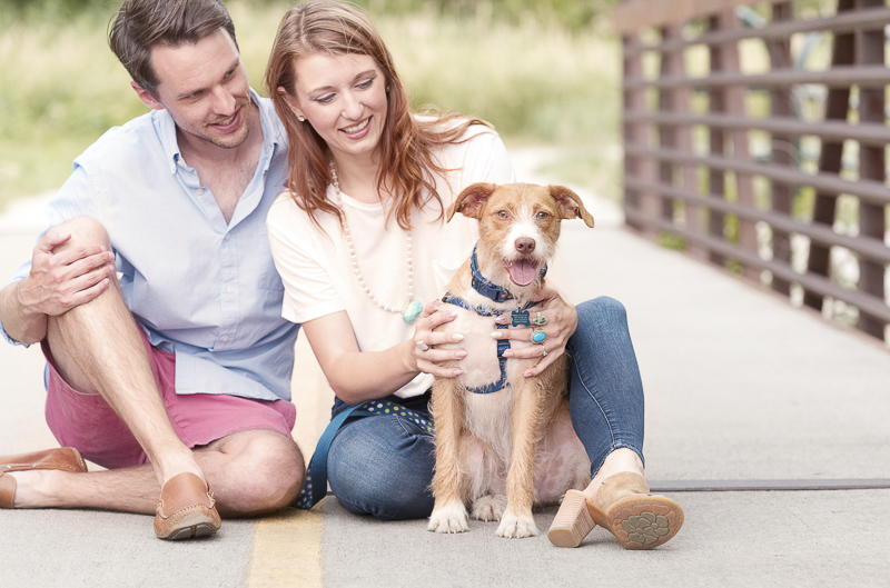 couple sitting with dog on bridge,   ©Good Morrow Photography, CO dog-friendly engagement photos