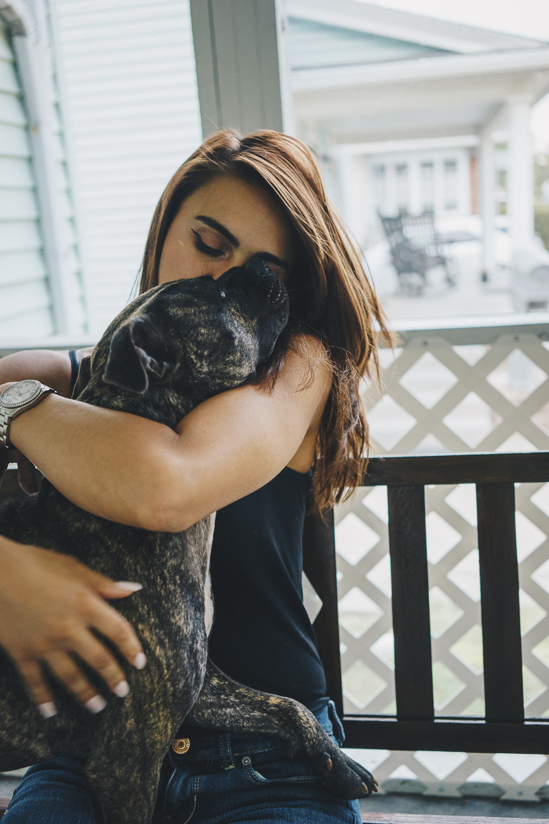 young woman snuggling with her dog, Pit bulls are great pets, | ©Heck Designs and Photography