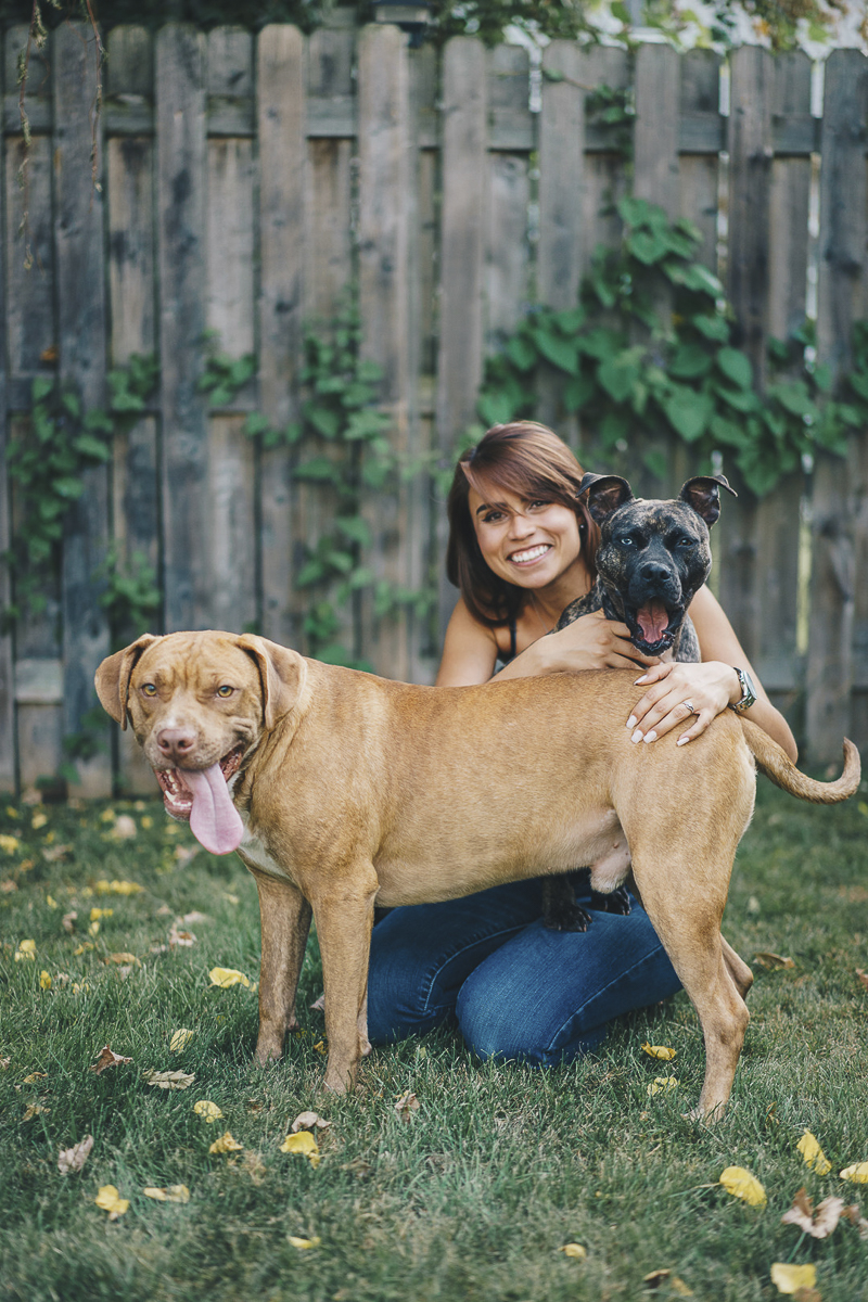 woman and her dogs in the yard, lifestyle dog photography, Pit bull advocacy | ©Heck Designs and Photography
