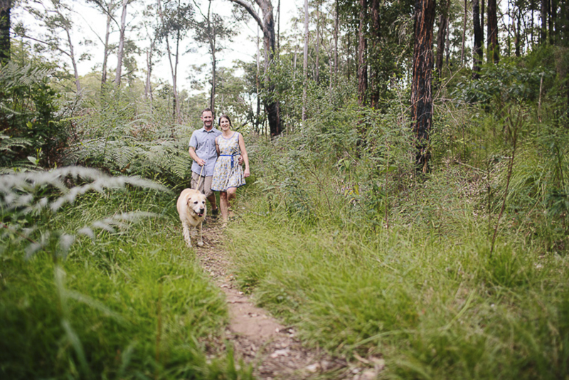 couple walking their dog through Australian bush, ©Hilary Cam Photography, including dogs in engagement photos