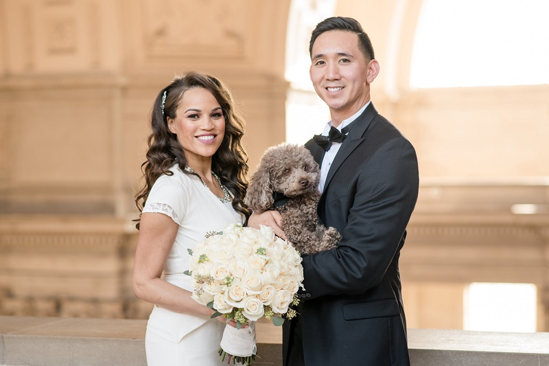 dog friendly wedding SF City Hall, bride and groom holding toy poodle ©Holly D Photography