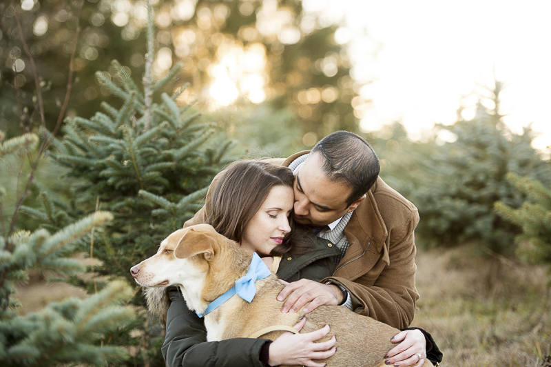 couple and their dog at Christmas tree farm, creative pet photography ideas | ©Julia Jane Studios,