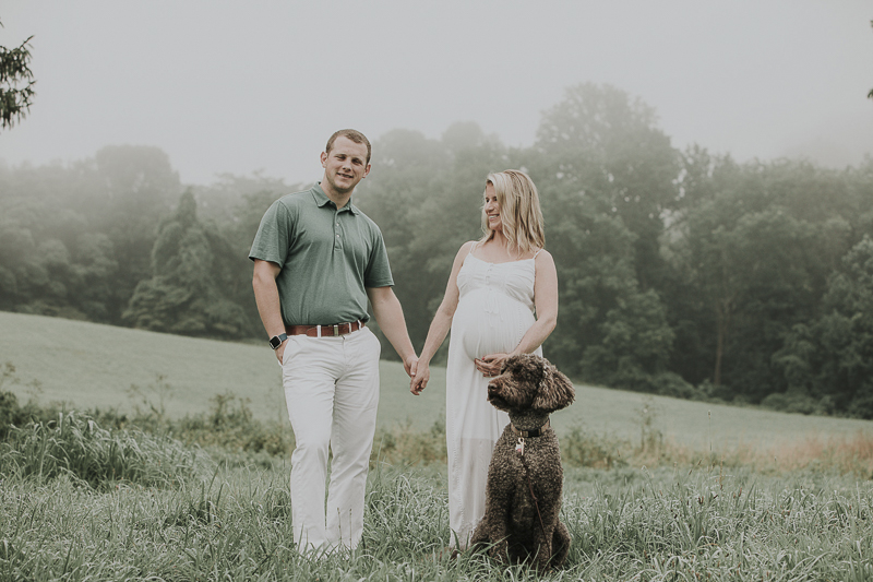 couple holding hands, handsome dog, sunrise session, muted greens, ©Kelli Wilke Photography | dog-friendly maternity session