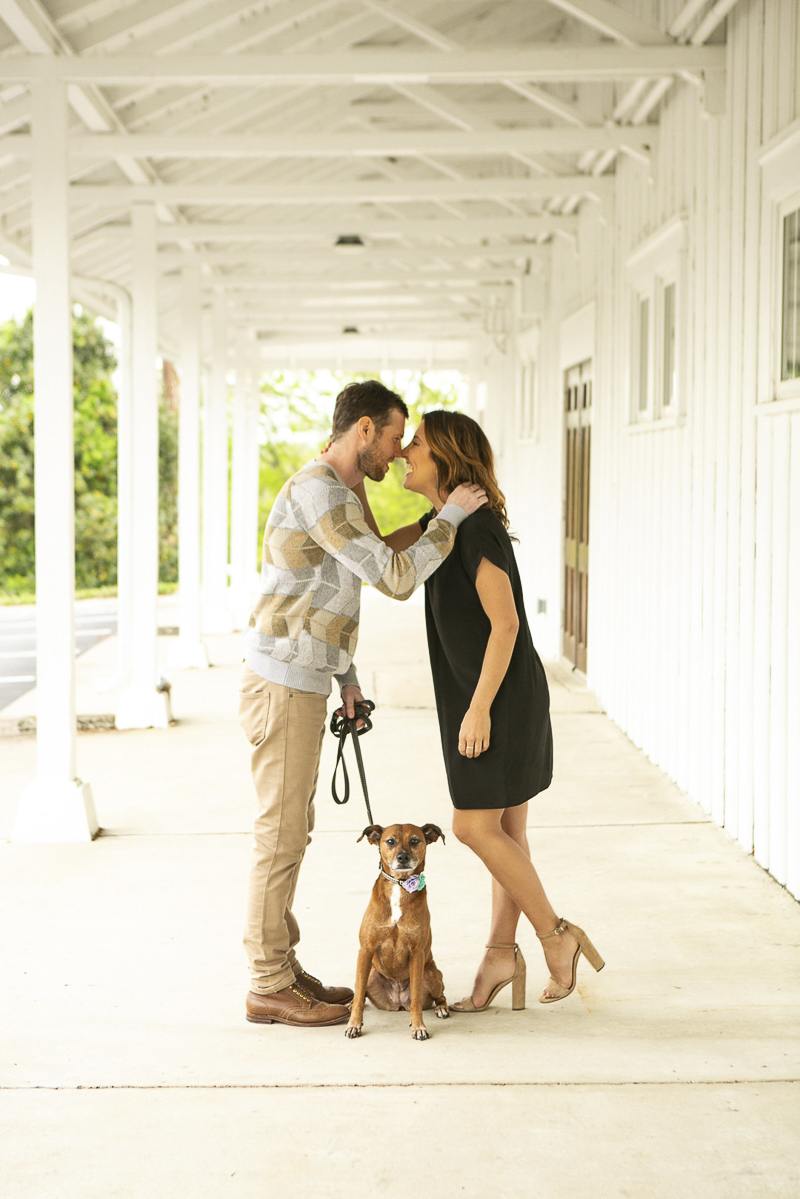 couple facing each other with dog between them, cute family portraits with dog, ©Mandy Whitley Photography | Nashville lifestyle photography