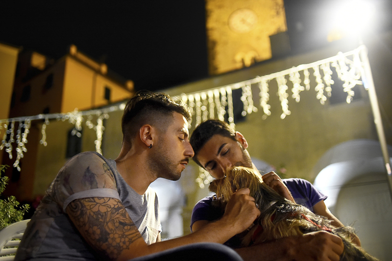 couple and their Yorkie mix, nighttime engagement portraits | ©Martina Campolo Photography