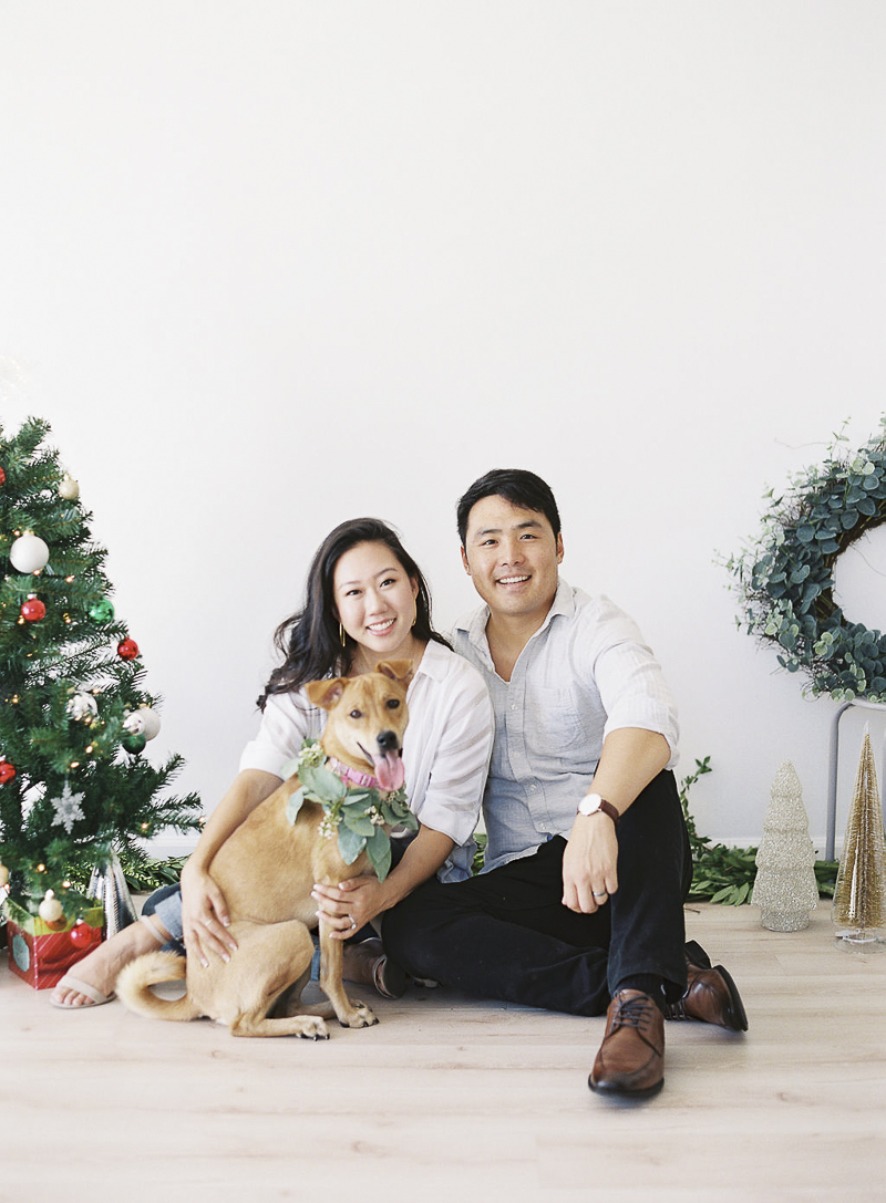 ©Stephanie Gan Photography | Studio holiday photos with a dog, sweet and simple holiday decor for portraits, dog photography ideas
