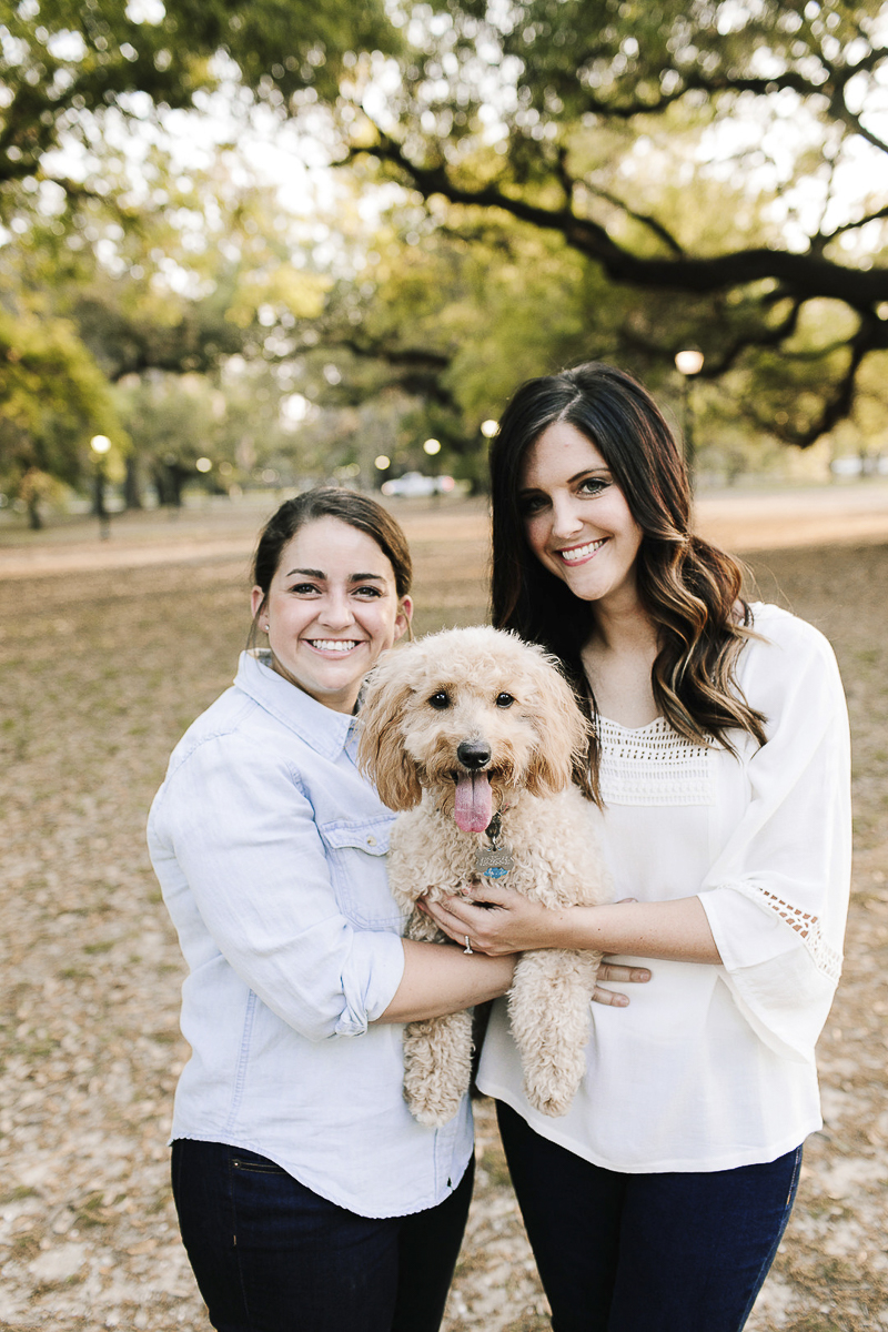 couple holding their goldendoodle, out door engagement photos with a dog, same sex engagement photos, New Orleans, ©Theresa Elizabeth Photography