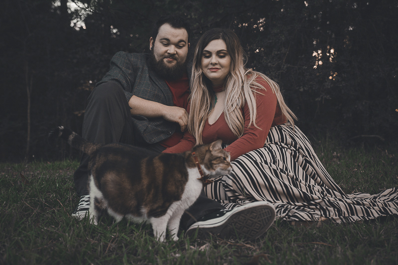 couple sitting on the ground with their cat, ©Admyer Studios | cat-friendly engagement photos