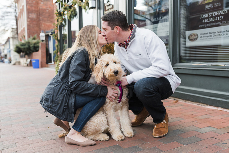 couple kissing over their dog, ©Ashton Kelly Photography | engagement session with a dog, Annapolis, MD