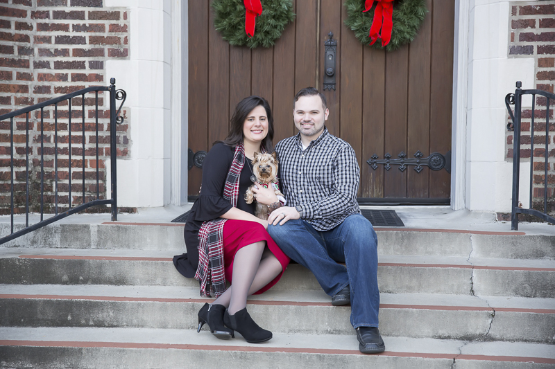 couple and their dog sitting on church steps, holiday photos with a Yorkie