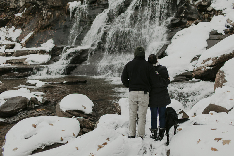 couple and their dog looking at waterfall, winter wonderland, ©Belle La Vie Images | Hudson Valley dog friendly engagement pictures