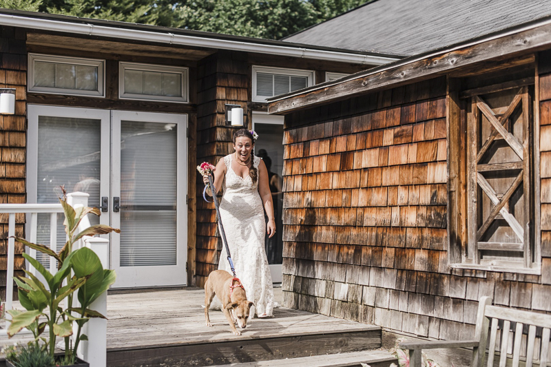 happy bride walking her dog | ©Landrum Photography | dog-friendly wedding