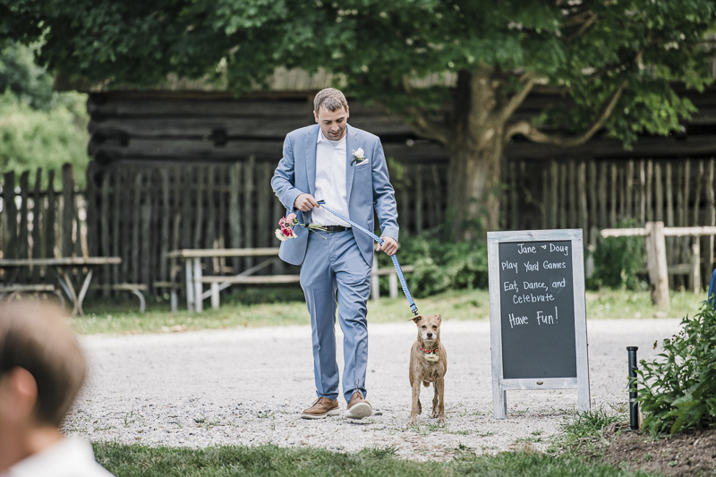 Groom walking flower girl dog | ©Landrum Photography | dog-friendly wedding