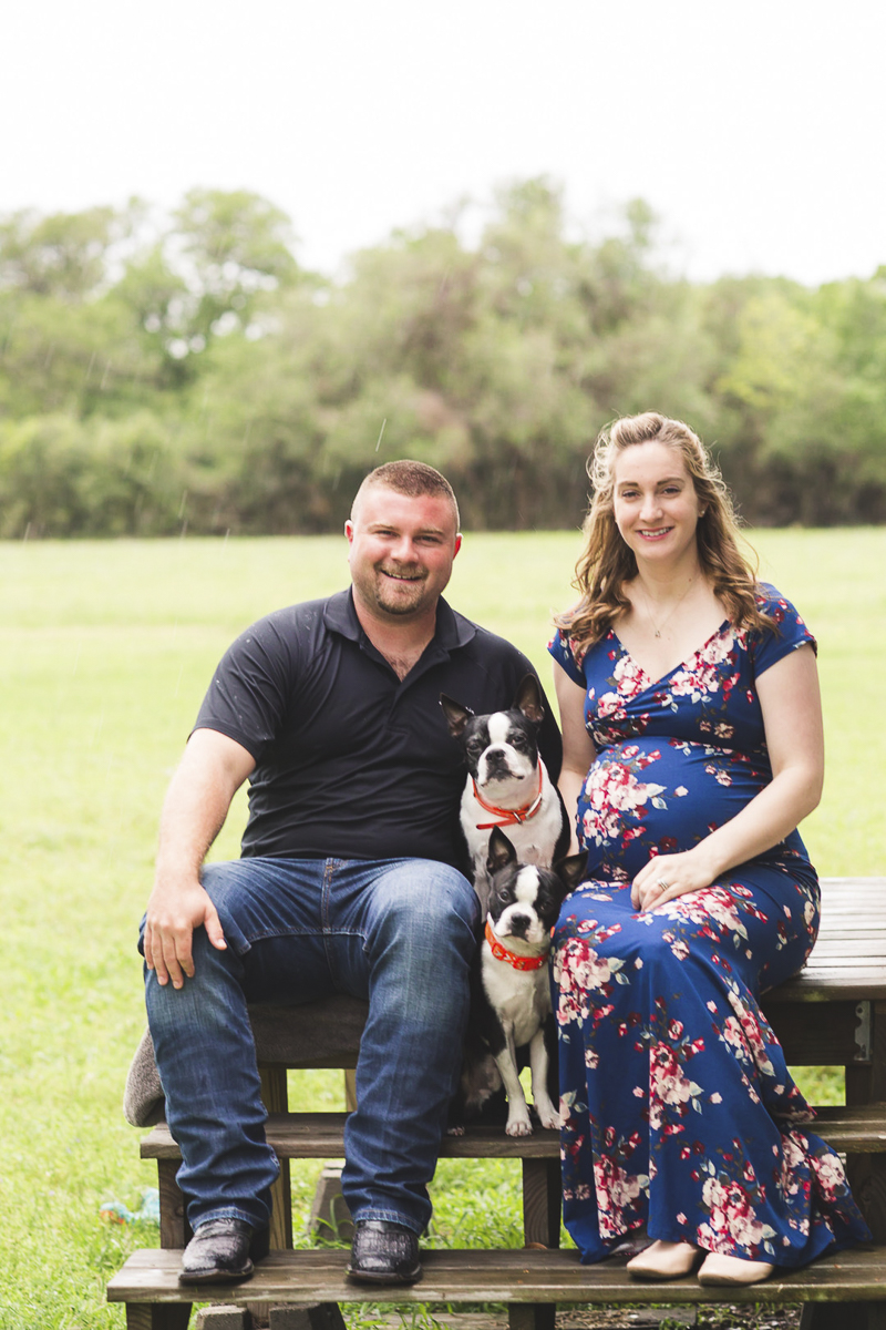 couple sitting with their dogs on picnic table, ©Amber Elaine Photography- maternity photos with dogs