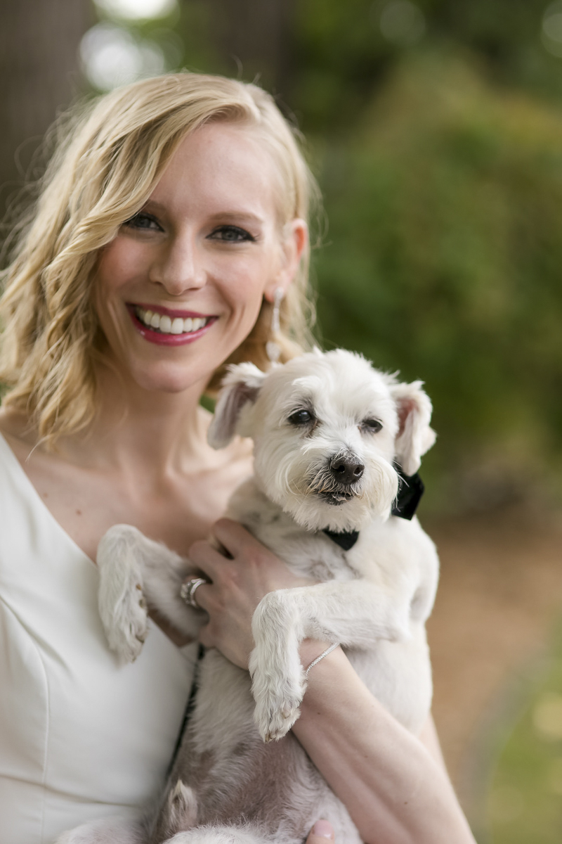 bride holding her cute rescue dog, little white dog, wedding photos with dogs | ©Jeannine Marie Photography
