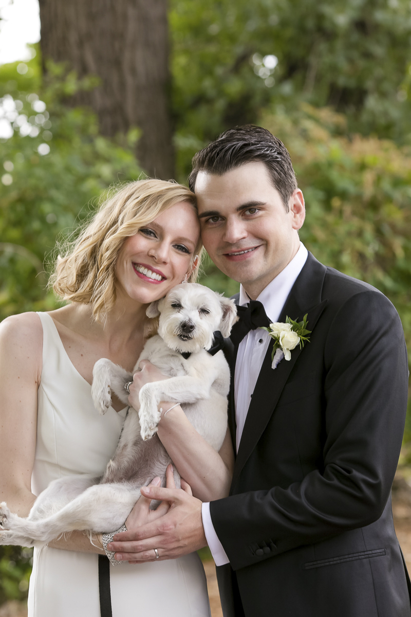 just married, bride and groom holding their rescue dog | ©Jeannine Marie Photography -dog-friendly wedding photographer