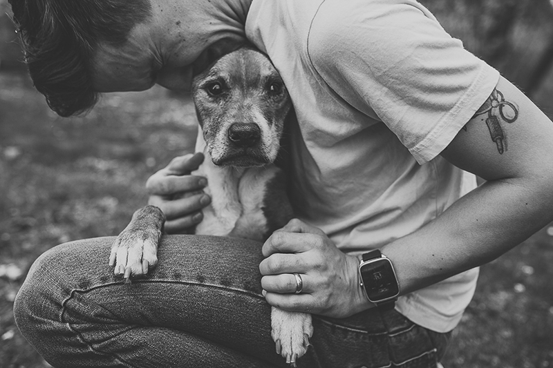 man resting head on dog's head, end of life dog photography, bond between humans and dogs | ©Nicole Maddalone Photography | lifestyle dog and family photography
