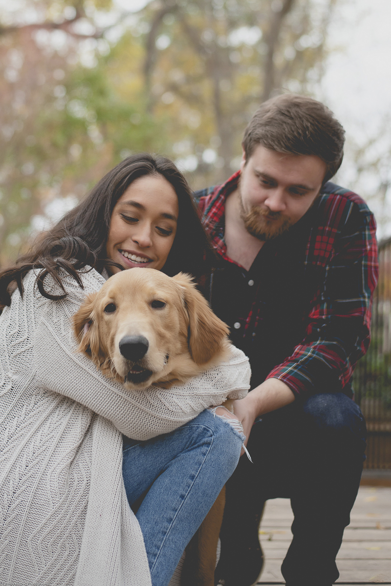 engaged couple looking lovingly at their Golden Retriever puppy | ©Tammy Klepac Photography