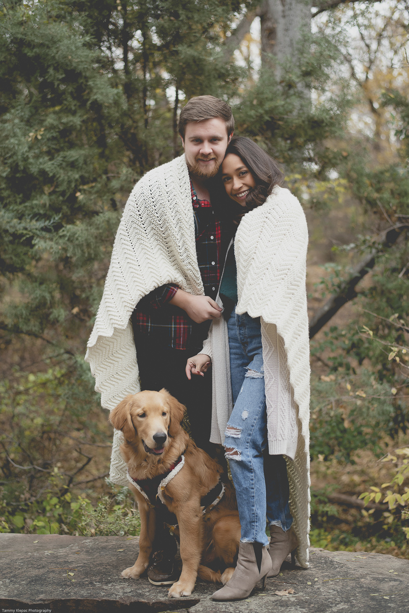 couple wrapped in ecru blanket, standing with their dog in front of them, engagement portrait ideas, dog friendly engagement poses | ©Tammy Klepac Photography