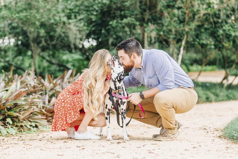couple kissing their dog | ©Kenzie Rae Photography | Ormond Beach dog photographer