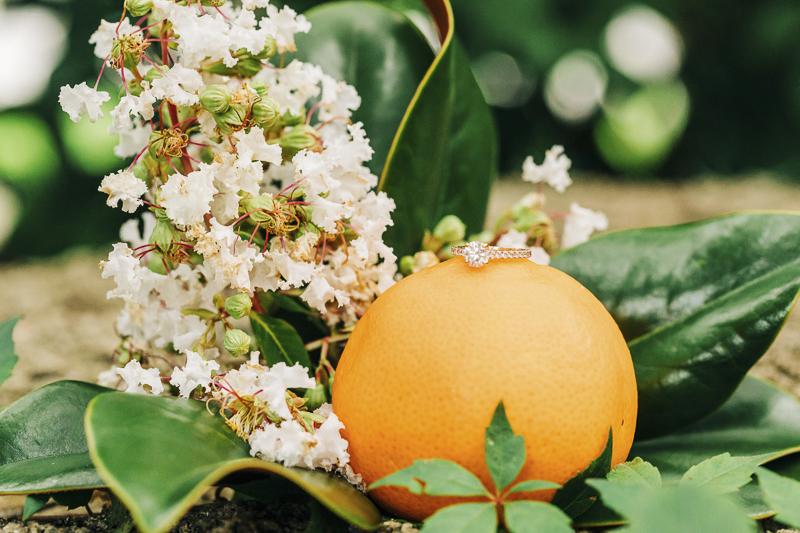 ©Kenzie Rae Photography | ring shot with orange and orange blossoms, Florida engagement photography