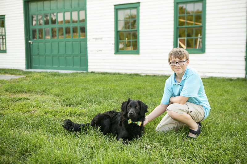 black puppy wearing bow tie and ten year old boy, ©Mandy Whitley Photography | Nashville puppy portraits