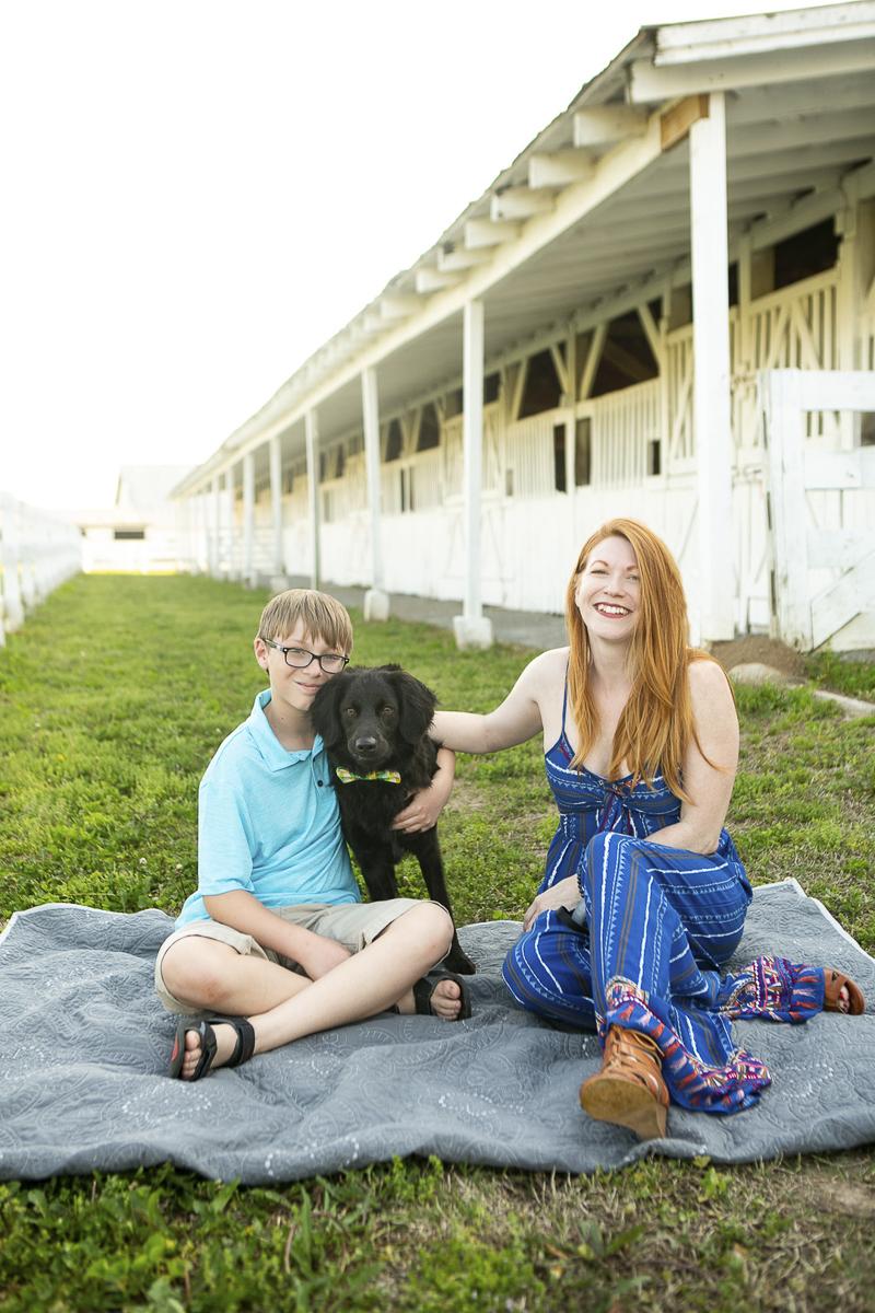 dog leaning on boy, family portraits at horse farm, ©Mandy Whitley Photography | Nashville puppy portraits