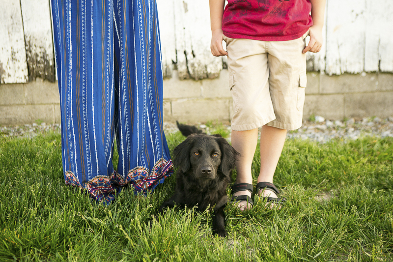 puppy laying between boy and his mom, family pictures with dogs, ©Mandy Whitley Photography
